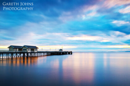 Colourful long exposure of Penarth Pier at sunrise