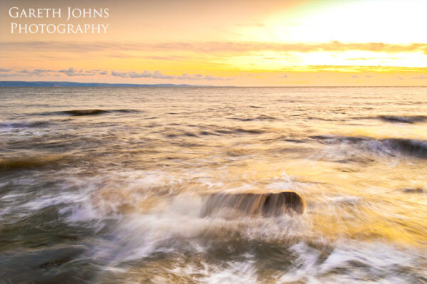 Incoming tide at sunset on Southerndown beach
