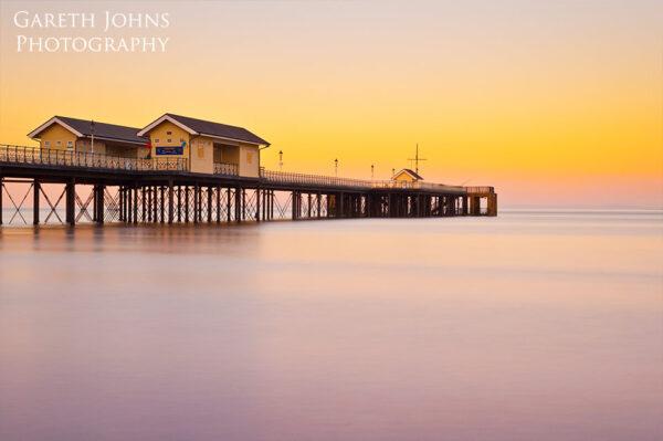 Long exposure of Penarth pier sunrise