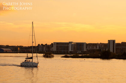 Sunset over Cardiff Bay with boat